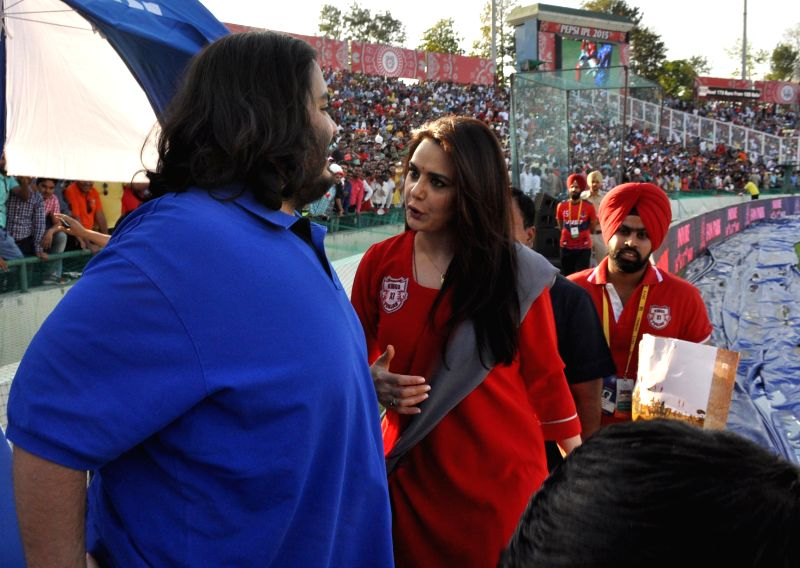 The co-owner of Kings XI Punjab actress Preity Zinta with Anant Ambani during an IPL-2015 match between Mumbai Indians and Kings XI Punjab at the Punjab Cricket Association Stadium, in Mohali ... - Preity Zinta and Anant Ambani