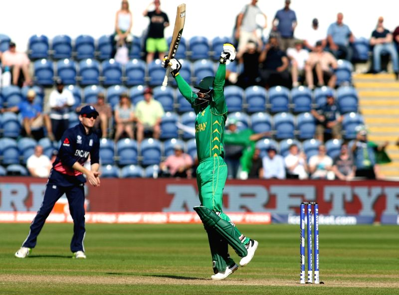 Mohammad Hafeez of Pakistan celebrates after winning the first Semi-final match of ICC Champions Trophy between England and Pakistan at Sophia Gardens in Cardiff, Wales, Britain on June 14, ...
