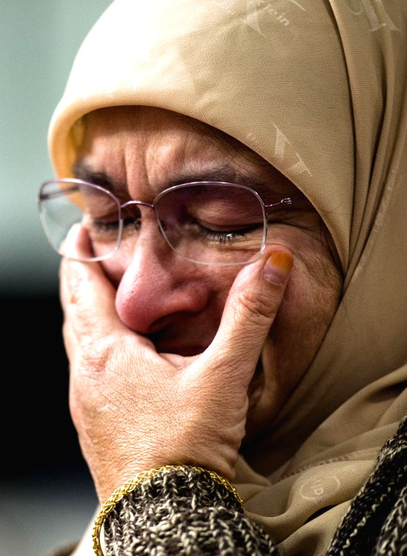 Mohammadi Murtuza-Siddiqui, a local Muslim woman, bursts into tears as she attends a gathering to mourn victims who were killed in the recent deadly shooting ...