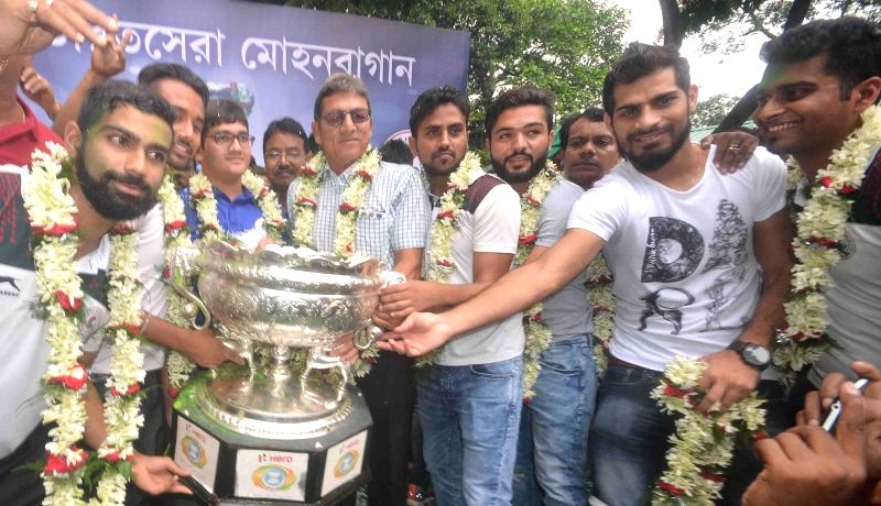 Mohun Bagan A.C team celebrates after winning the 14th Federation Cup in Kolkata, on May 25, 2016.