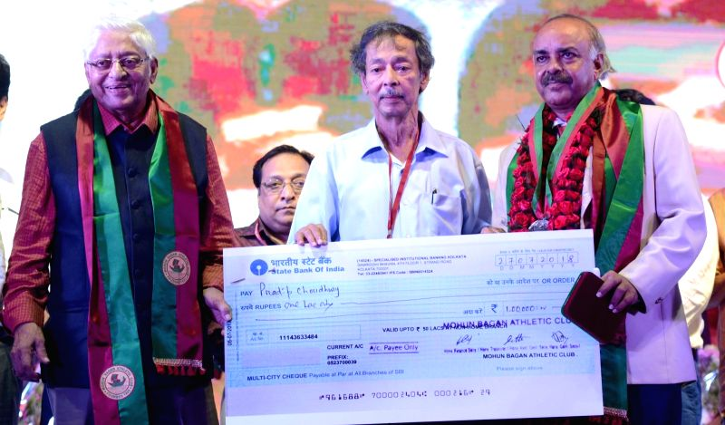 Mohun Bagan Secretary Anjan Mitra felicitates veteran footballer Pradip Choudhury during Mohun Bagan Day celebrations in Kolkata on July 29, 2018. - Pradip Choudhury