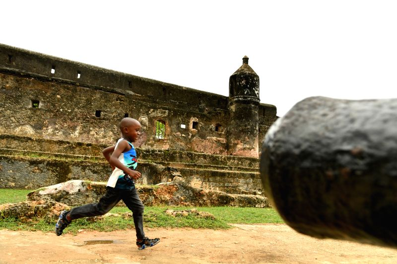 MOMBASA, April 29, 2017 - A boy runs past an old cannon at Fort Jesus in Mombasa, Kenya, April 29, 2017. Located in the Southeastern corner of Mombasa city, Fort Jesus was built by Portuguese ...