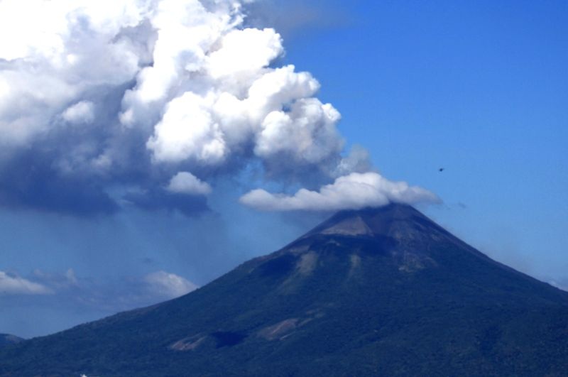 Momotombo Volcano spews large clouds of gas and ash in La Paz Centro municipality, Leon department, western Nicaragua, on Dec. 2, 2015. Momotombo Volcano, located in ...