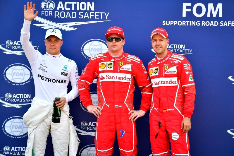 MONACO, May 28, 2017 - (L to R) Mercedes driver Valtteri Bottas of Finland, Ferrari driver Kimi Raikkonen of Finland and German driver Sebastian Vettel pose after the qualification session of the ...