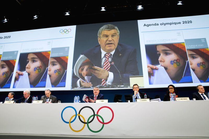 Photo povided by IOC shows International Olympic Committee (IOC) President Thomas Bach (C) delivering a speech during the opening of the 127th IOC session in Monaco Dec. 8, 2014.
