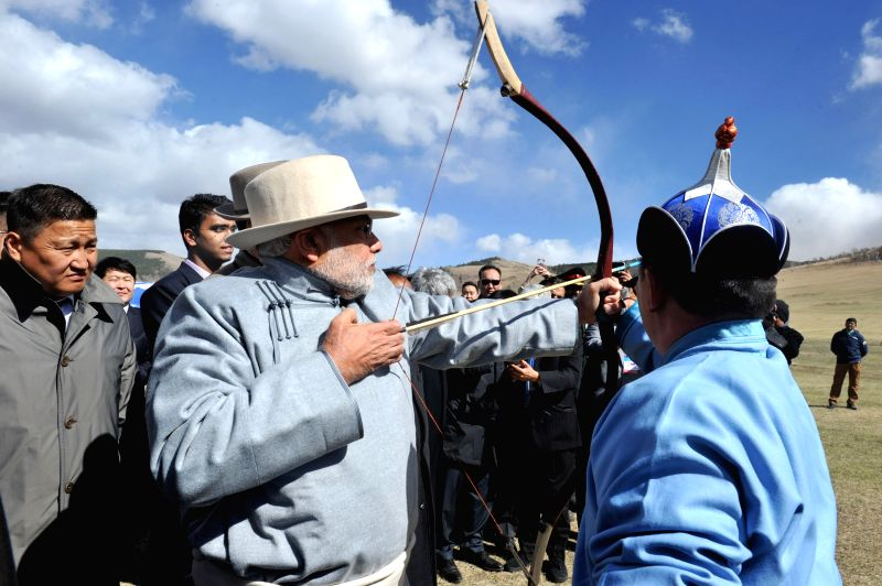 Prime Minister Narendra Modi try his hand on archery at Mini Naadam Festival, in Ulaanbaatar, Mongolia on May 17, 2015. - Narendra Modi