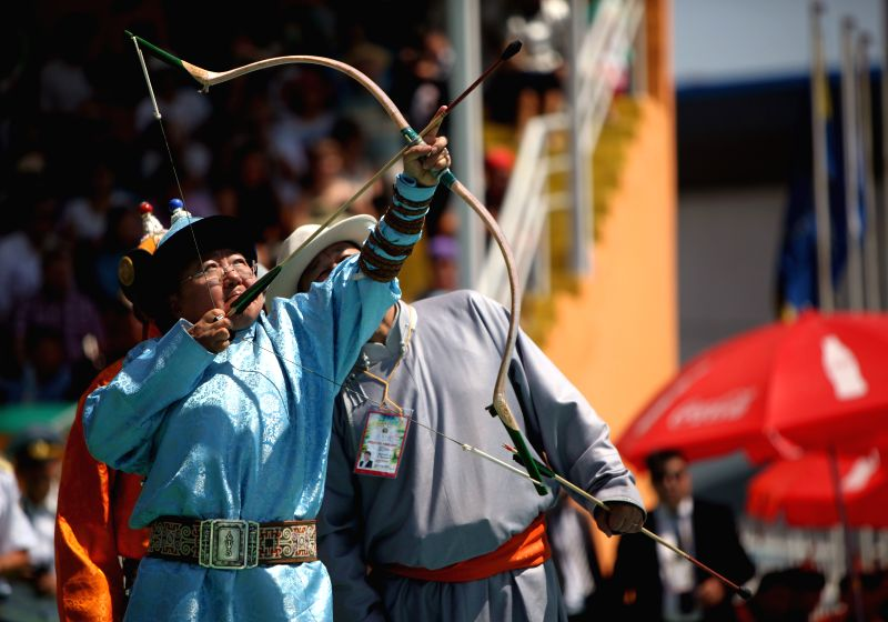 Mongolian President Tsakhia Elbegdorj attends an archery performance during the opening ceremony of the annual Nadam Fair in Ulan Bator, capital of Mongolia, on ...