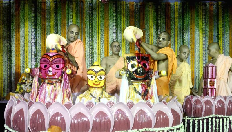 Monks worship Lord Jagannath on Lord Jagannath Snan Yatra in Kolkata on June 9, 2017.