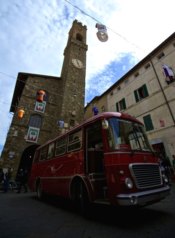 MONTALCINO, May 9, 2017 - A car stops at the center of Montalcino, Italy, on May 6, 2017. Montalcino is a medieval hill town in Tuscany of Italy. It is famous for the surrounding picturesque ...