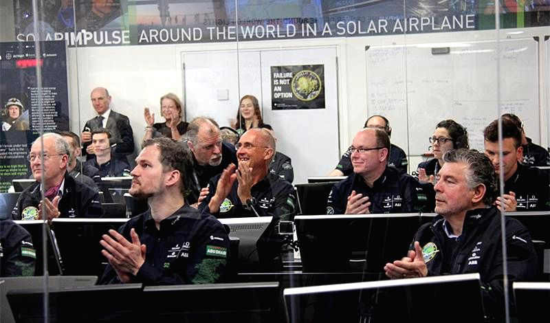 Staff of the Solar Impulse 2 (Si2) project in the control center at Monte Carlo of Monaco applause after the solar-powered aircraft took off from Abu Dhabi of ...