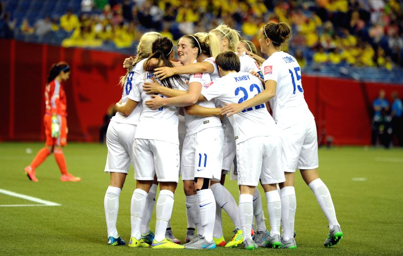 England's players celebrate for a goal against Colombia during the Group F match at the 2015 FIFA Women's World Cup in Montreal, Canada, on June 17, 2015. England ...