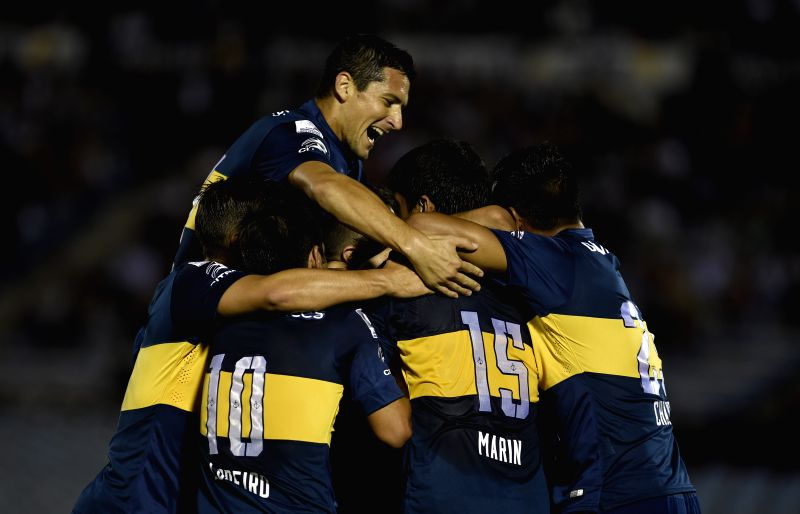 Argentine Boca Juniors' players celebrate a score during the match of the Libertadores Cup 2015 against Wanderers of Uruguay, held at Centenario stadium in ...