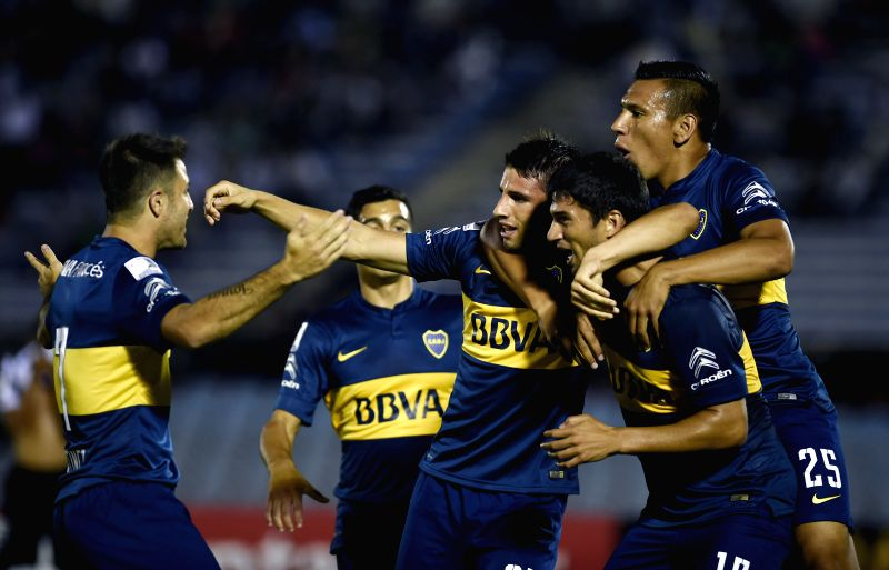 Argentine Boca Juniors' Jonathan Calleri (C) celebrates a score during the match of the Libertadores Cup 2015 against Wanderers of Uruguay, held at Centenario ...