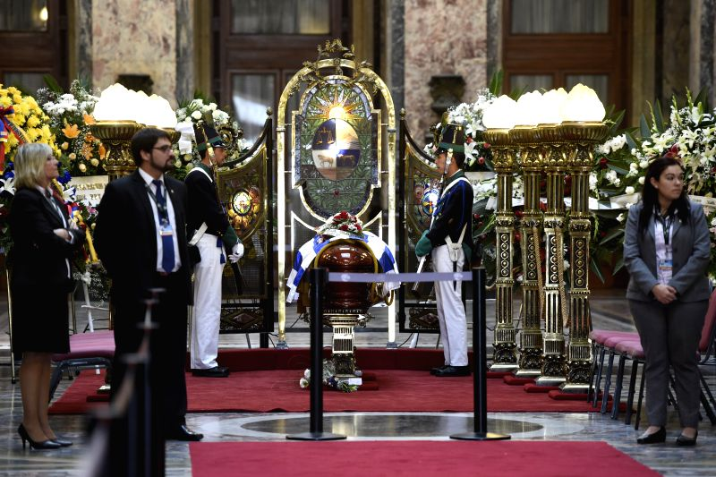 Members of an honor guard watch over the coffin of Uruguayan writer Eduardo Galeano in the Lost Steps Hall of the Legislative Palace in Montevideo, capital of ...