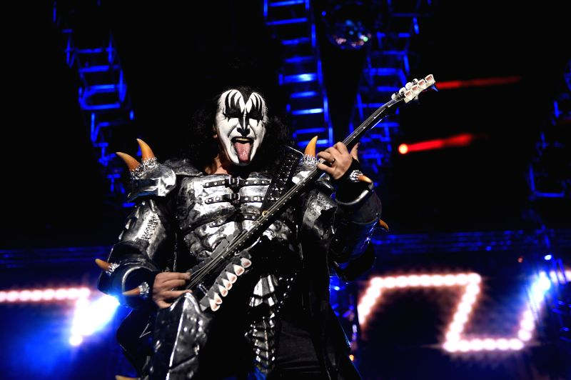 "Gene Simmons of the U.S. band ""Kiss"" plays an bass during a concert of the tour ""40th Anniversary"" in the Gran Parque Central stadium, in ..."