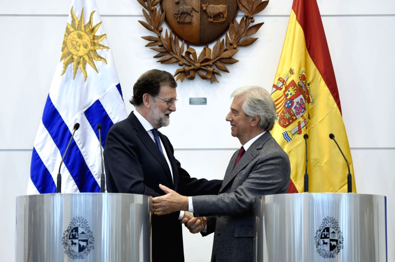 MONTEVIDEO, April 27, 2017 - Uruguay's President Tabare Vazquez (R) shake hands with Spanish Prime Minister Mariano Rajoy after a joint press conference in Montevideo, capital of Uruguay, on April ... - Mariano Rajoy