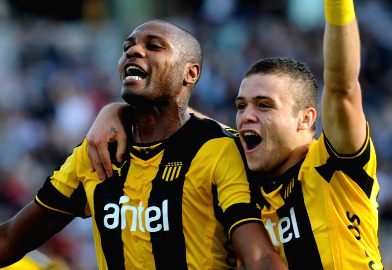 The player Marcelo Zalayeta (L) of Penarol, celebrates a scoring with Jonathan Rodriguez (R), during the soccer game of the Uruguayan Closing Tournament in the .