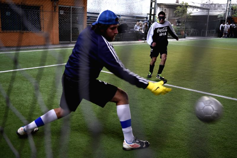 Players of the Uruguayan national soccer team of blind people attend a training session in Montevideo, capital of Uruguay, Aug. 12, 2014.  In 1986, the first ...