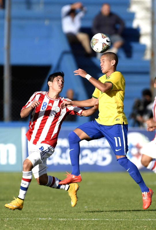 Paraguay's Gustavo Viera (L) vies with Brazil's Marcos Guilherme in a soccer match of the South American U-20 tournament in the Gran Parque Stadium, in ...