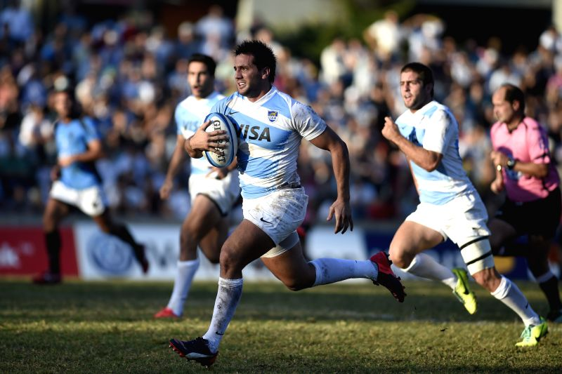 Uruguay's Matias Orlando (back) vies for the ball with Argentina's Facundo Isa (front) during the match of Confederation South American of Rugby Consur Cup 2015, ...