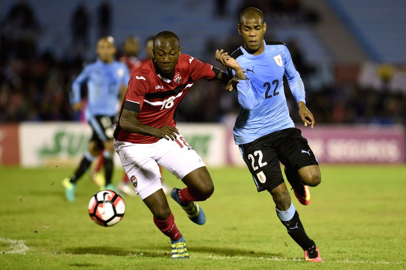 MONTEVIDEO, May 28, 2016 - Uruguay's Diego Rolan (R) vies with Daneil Cyrus (L) of Trinidad and Tobago during the international friendly match in Montevideo, Uruguay, on May 27, 2016.