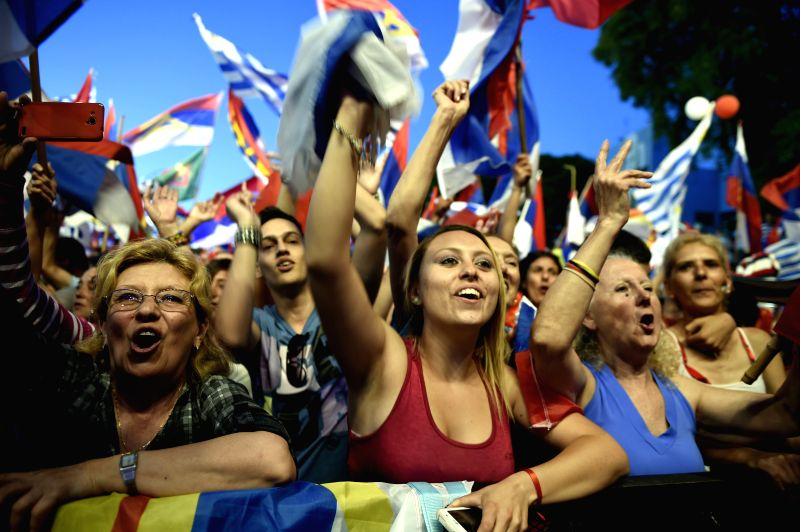 Montevideo (Uruguay): Supporters of Tabare Vazquez, presidential candidate for the ruling party Broad Front and former president, attend his closing running campaign in Montevideo, capital of ...