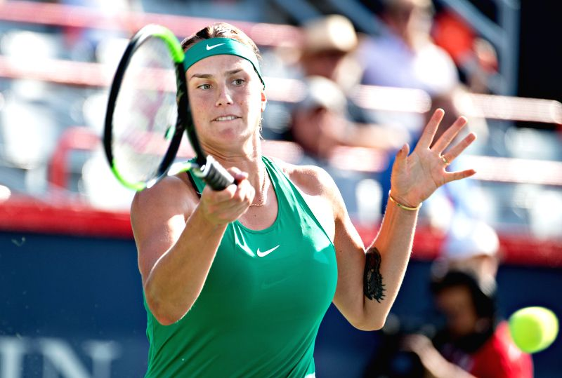 MONTREAL, Aug. 10, 2018 - Aryna Sabalenka of Belarus hits a return during the women's singles second round match against Caroline Wozniacki of Denmark at the 2018 Rogers Cup in Montreal, Canada, on ...