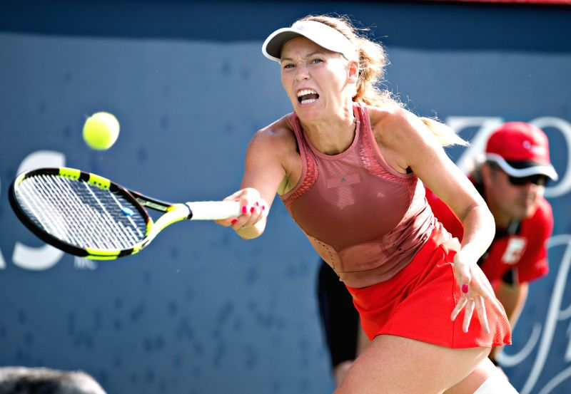 MONTREAL, Aug. 10, 2018 - Caroline Wozniacki of Denmark hits a return during the women's singles second round match against Aryna Sabalenka of Belarus at the 2018 Rogers Cup in Montreal, Canada, on ...