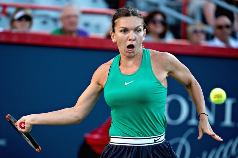 MONTREAL, Aug. 11, 2018 - Simona Halep of Romania returns the ball to Caroline Garcia of France during the quarterfinal match of women's singles at the 2018 Rogers Cup in Montreal, Aug. 10, 2018. ...