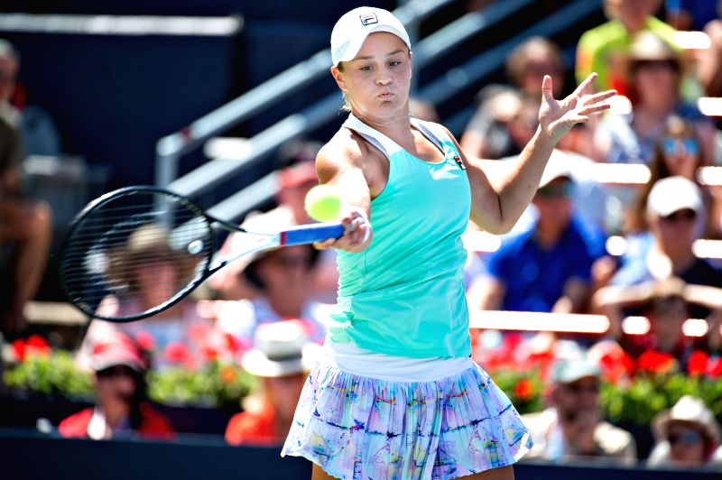MONTREAL, Aug. 12, 2018 - Ashleigh Barty of Australia returns the ball to Simona Halep of Romania during the semifinal match of women's singles at the 2018 Rogers Cup in Montreal, Aug. 11, 2018. ...
