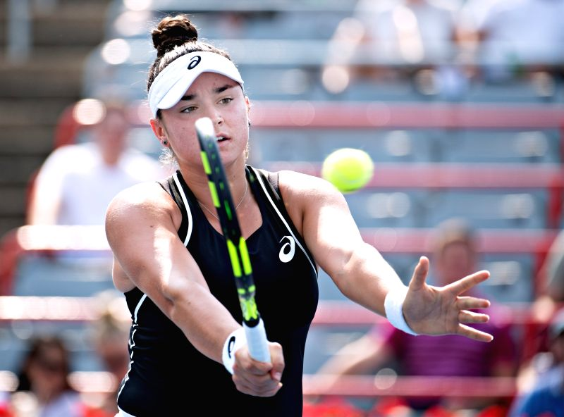 MONTREAL, Aug. 7, 2018 - Caroline Dolehide of the United States hits a return during the first round of women's singles match against Venus Williams of the United States at the 2018 Rogers Cup in ...