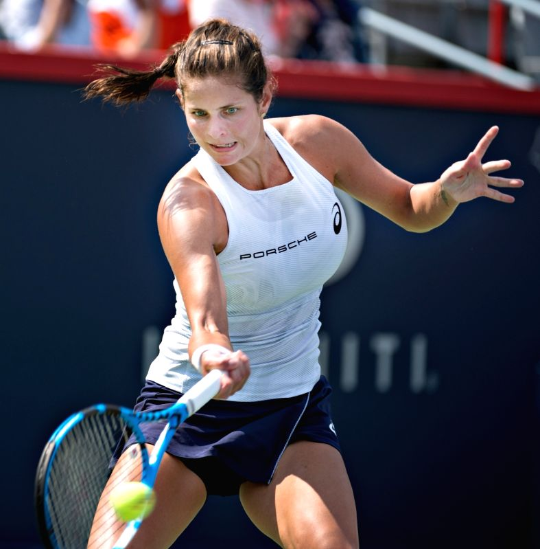 MONTREAL, Aug. 7, 2018 - Julia Goerges of Germany hits a return during the first round of women's singles match against Timea Babos of Hungary at the 2018 Rogers Cup in Montreal, Canada, Aug. 6, ...