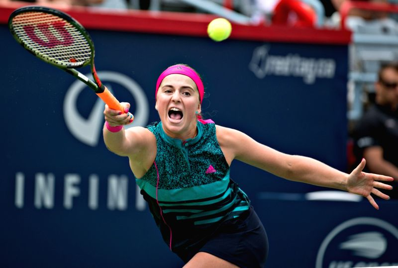 MONTREAL, Aug. 8, 2018 - Jelena Ostapenko of Latvia hits a return during the first round of women's singles match against Johanna Konta of Britain at the 2018 Rogers Cup in Montreal, Canada, Aug. 7, ...
