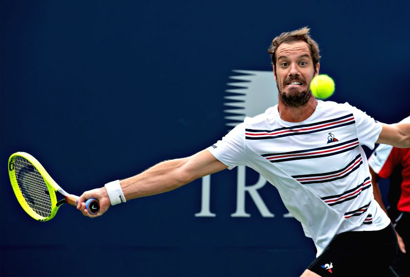 MONTREAL, Aug. 8, 2019 (Xinhua) -- Richard Gasquet of France returns the ball during the men's singles second round match against Kei Nishikori of Japan in Montreal, Canada on Aug.7, 2019. (Xinhua/Andrew Soong/IANS)