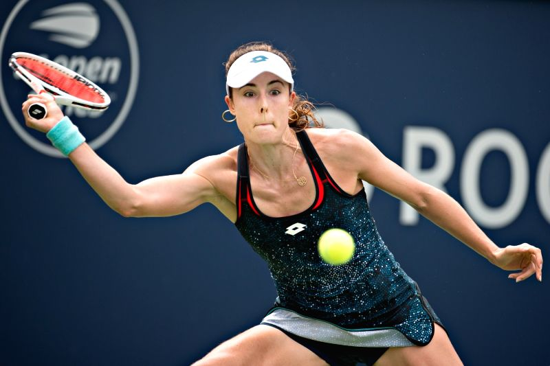 MONTREAL, Aug. 9, 2018 - Alize Cornet of France returns the ball to Angelique Kerber of Germany during the women's singles second round match at the 2018 Rogers Cup in Montreal, Canada, on Aug. 9, ...