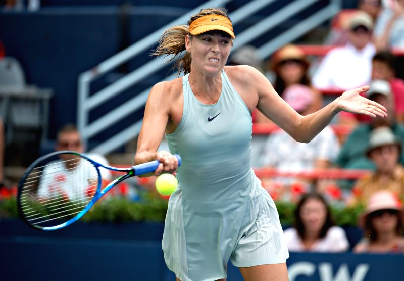 MONTREAL, Aug. 9, 2018 - Maria Sharapova of Russia hits a return during the second round of women's singles match against Daria Kasatkina of Russia at the 2018 Rogers Cup in Montreal, Canada, Aug. 8, ...