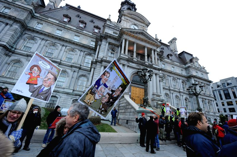 Montreal (Canada): People take part in a protest in Montreal, Canada, on Nov. 26, 2014. More than 4500 employees from local governments of Canadian Quebec province took to street in Montreal ...