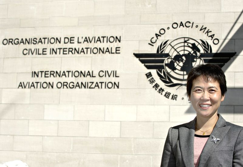 Liu Fang poses for photos outside the building of the International Civil Aviation Organization (ICAO) in Montreal, Canada, March 11, 2015. Liu Fang, a Chinese ...