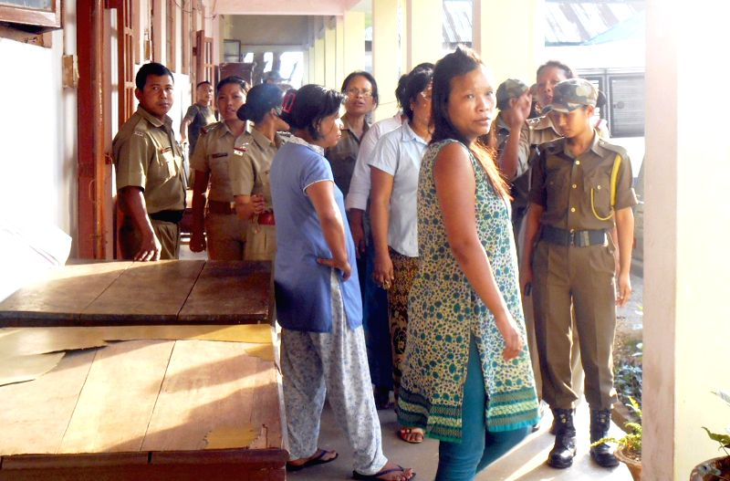 Moral activists Jaynie Ningring N. Sangma, Konica S. Sangma, Lonavi R Sangma and Jaynie Ningring N Sangma being taken to be produced at a court in Tura of Meghalaya  on May 9, 2014.