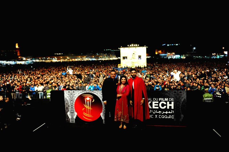 Film Director Farah Khan, actors Abhishek Bachchan and Boman Irani at the red carpet to present the film 'Happy New Year' at the 14th Marrakech International Film Festival in Morocco on Dec . - Abhishek Bachchan, Boman Irani and Farah Khan