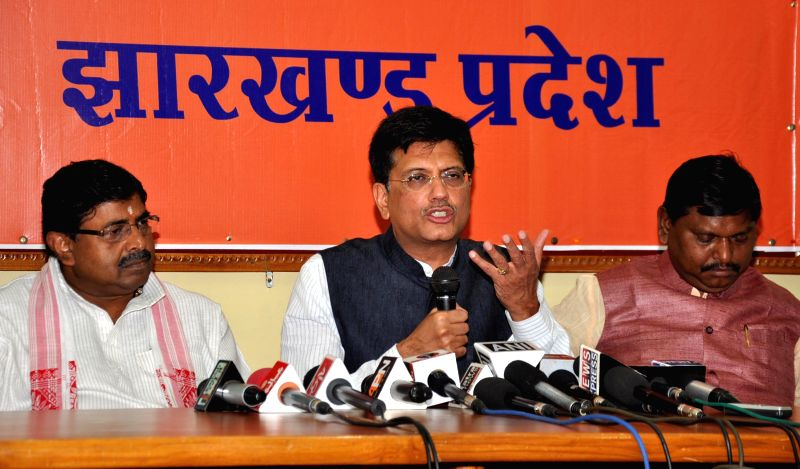 MoS (Independent Charge) for Power, Coal and New and Renewable Energy Piyush Goyal during a press conference at BJP headquarters in Ranchi on Aug 20, 2014. Also seen  former Jharkhand Chief Minister . - Arjun Munda and Ravindra Rai