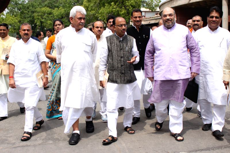 MoS Railways Manoj Sinha, Union MoS for Skill Development and Entrepreneurship (Independent Charge) and Parliamentary Affairs Rajiv Pratap Rudy, BJP leader Vijay Goel and others with BJP ... - Manoj Sinha