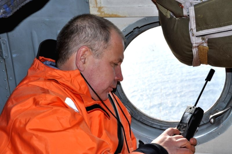 A ruscuer works on a helicopter after a trawler sank in the Sea of Okhotsk off the Kamchatka Peninsula, April 2, 2015. At least 54 people have been confirmed dead in ...