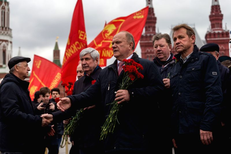 MOSCOW, April 22, 2017 - Gennady Zyuganov (C), leader of the Russian Communist Party, attends a laying flower ceremony at Lenin's mausoleum in Moscow, Russia, on April 22, 2017. People participated ...