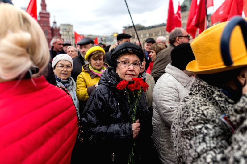 MOSCOW, April 22, 2017 - Supporters of the Russian Communist Party attend a laying flower ceremony at Lenin's mausoleum in Moscow, Russia, on April 22, 2017. People participated in a laying flower ...