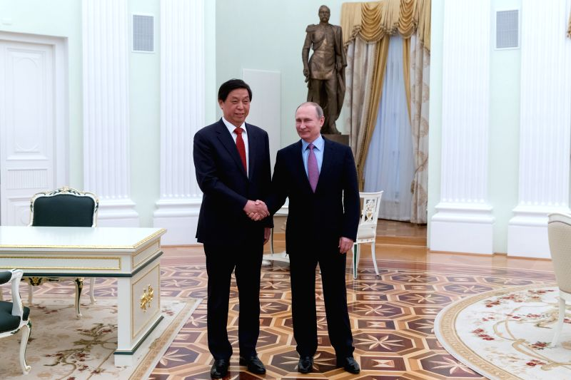 MOSCOW, April 27, 2017 - Russian President Vladimir Putin (R) meets with Li Zhanshu, a member of the Political Bureau of the Central Committee of the Communist Party of China (CPC) and member of the ...