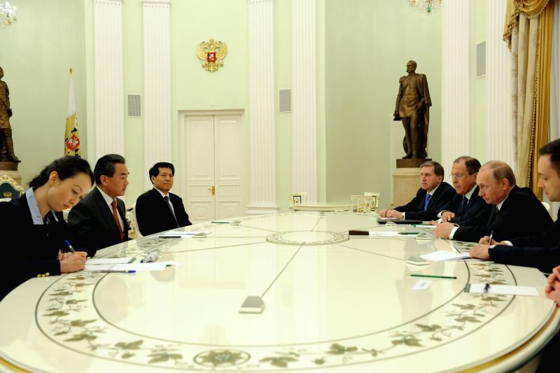 Russian President Vladimir Putin (2nd R) meets with Chinese Foreign Minister Wang Yi (2nd L) in Moscow April 7, 2015. - Wang Y