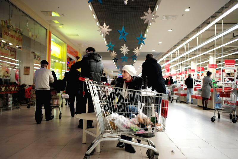 A woman waits for her family while shopping at a supermarket in Moscow, Russia, Dec. 17, 2014. Russian Prime Minister Dmitry Medvedev on Wednesday warned citizens ... - Dmitry Medvedev