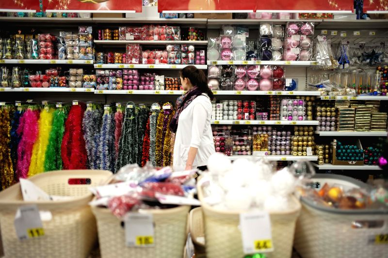 A woman walks at a supermarket in Moscow, Russia, Dec. 17, 2014. Russian Prime Minister Dmitry Medvedev on Wednesday warned citizens and companies of attempting to ..