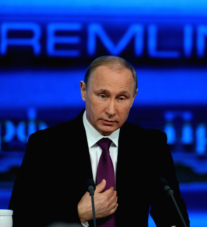 Russian President Vladimir Putin attends the annual news conference in Moscow, capital of Russia, Dec. 18, 2014.